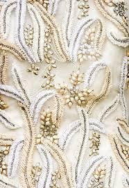 closeup of the fabric of an antique wedding dress with precious