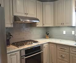 Kitchen With Glass Tile Backsplash Superb Complete Kitchen With Clean Cabinets Facing Oak Island For