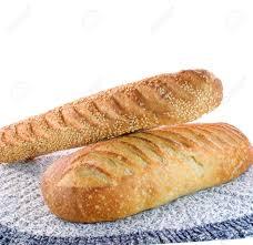 Bread Machine Sourdough Recipe Two Loaves Of Sourdough Bread On White Background Stock Photo
