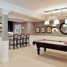 finished basement with wainscoting custom fireplace and wine bar