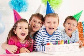 four happy children celebrating a birthday stock photo 517593337