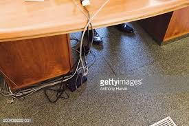 Under The Desk Foot Rest by Cables And Feet Under Office Desk Elevated View Stock Photo