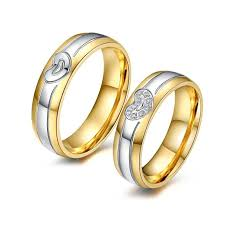 golden heart rings images Golden heart shaped couple rings evermarker jpg