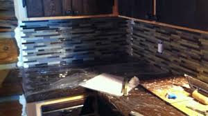 How To Install Glass Mosaic Tile Backsplash In Kitchen by Installing Mosaic Tile Backsplash In Log Cabin Part 2 Youtube