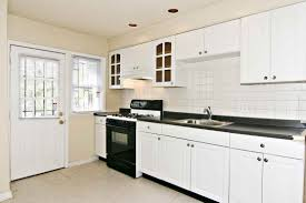 White Kitchen Cabinets Dark Wood Floors by White Kitchen Cabinets Dark Wood Floors Nucleus Home