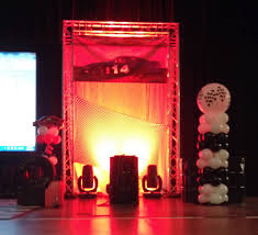 party people event decorating company race car theme stage decor