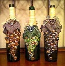repurposed glass bottles into creative decorations recycled