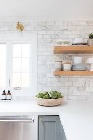 gray and white and marble kitchen reveal marble subway tiles