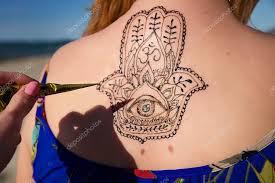 henna tattoo mehendy painted on back hamsa u2014 stock photo