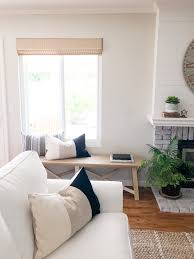 White Slipcovered Sofa by Cozy Traditional Farmhouse Style Renovation