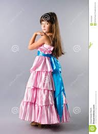 a cute posing in a prom dress in studio stock images