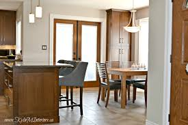 ceiling painted the same colour as the walls keeps a space low ceiling painted the same colour as the walls keeps a space low contrast and makes it look bigger kitchen with cherry cabinet tile floor and quartz