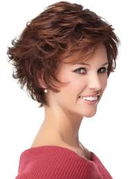 medium layered haircuts with thin wispy bangs for women over 50