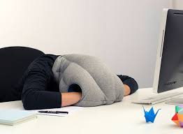 this pillow lets you comfortably take a nap wherever you are like your desk