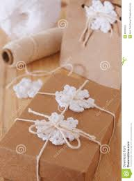 white crochet snowflakes for christmas decoration of gift box an