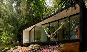 take refuge in this off grid bungalow tucked into the lush mexican