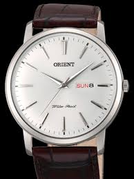 orient capital quartz analog dress with day and date window