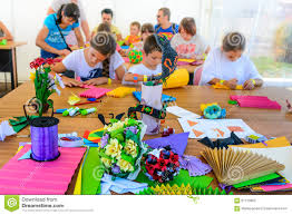 a group of children making crafts out of colored paper lifestyl