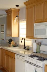kitchen lighting light over sink drum wood glam brown flooring