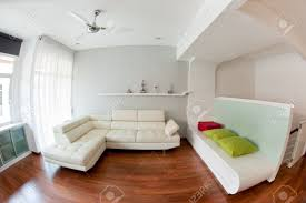 White Sofas In Living Rooms Modern Living Room With White Sofa Wooden Floor And Golf Trophy