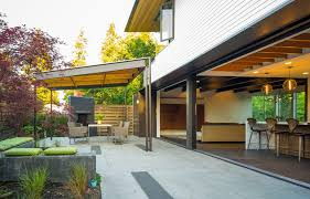 cedar patio covers porch traditional with red sun umbrella grill