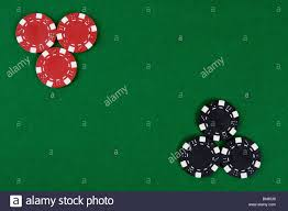 poker table top and chips two kinds of poker chips in two corners of a green poker table top