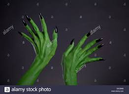 halloween themed background free green monster hands with black nails halloween theme studio shot