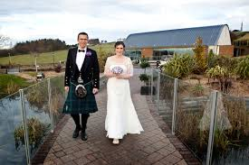a purple and pearls scottish wedding with a monsoon wedding dress