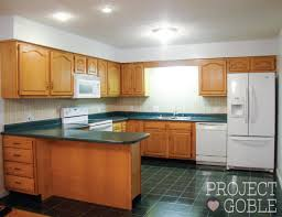 white kitchen cabinets with green countertops kitchen transformation white cabinets painted counters