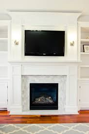 the fireplace fireplaces marble subway tiles and white doves
