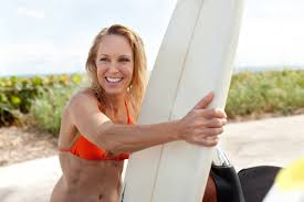middle aged women with surf boards at beach dr tess of beverly