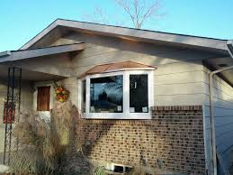 before after photo gallery window world of colorado copper roof bay window