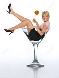 martini glass with olive young blond in a martini glass holding an olive stock photo