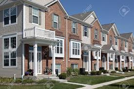 8793008 row of brick townhouses with covered entries stock photo