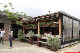 covered outdoor seating burgers and beer at goodfriend u0027s in dallas localsugar