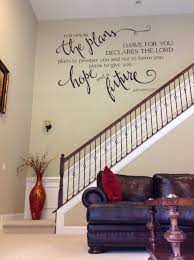 rooms halls amy colburn bible verse hand painted on wall above large staircase into main living area