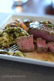beef tenderloin with shrimp and mushroom sauce cooking with curls