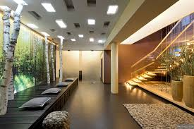 floating stairwell with pillars and glass panels pebble look rug floating stairwell with pillars and glass panels pebble look rug and furnishings and tree trunk feature wall