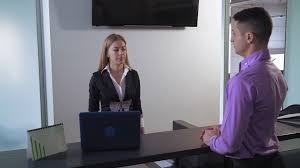 Standing Reception Desk by Client Signing Documents In Bank Man Standing Near