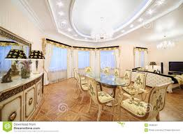 living and dining room with luxury gilt furniture royalty free