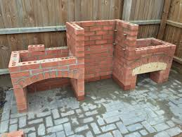 he takes a pile of bricks creates a stunning brick bbq perfect