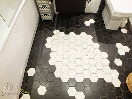 how to design small bathroom with hexagon tiles and mosaic quote