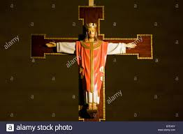 a fully clothed figurine of jesus christ on a cross on the high