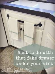 what to do with that fake drawer under your kitchen sink kitchen what to do with that fake drawer under your kitchen sink kitchen cabinet towel bar