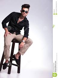High Sitting Chair Young Man Sitting On Chair Looks At Camera Royalty Free Stock