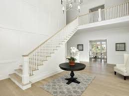 two story entry with round foyer table transitional entrance foyer