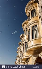 up view of pretty three story apartment houses with