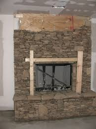 fireplace in progress kits cast stone surround natural fieldstone