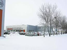 nissan canada head office jobs nissan dealer completes expansion adds staff winnipeg free press