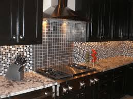 kitchen island with dining table stainless subway tile backsplash steel stove hood bronze brown